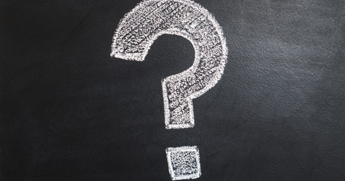 Large question mark on a chalkboard