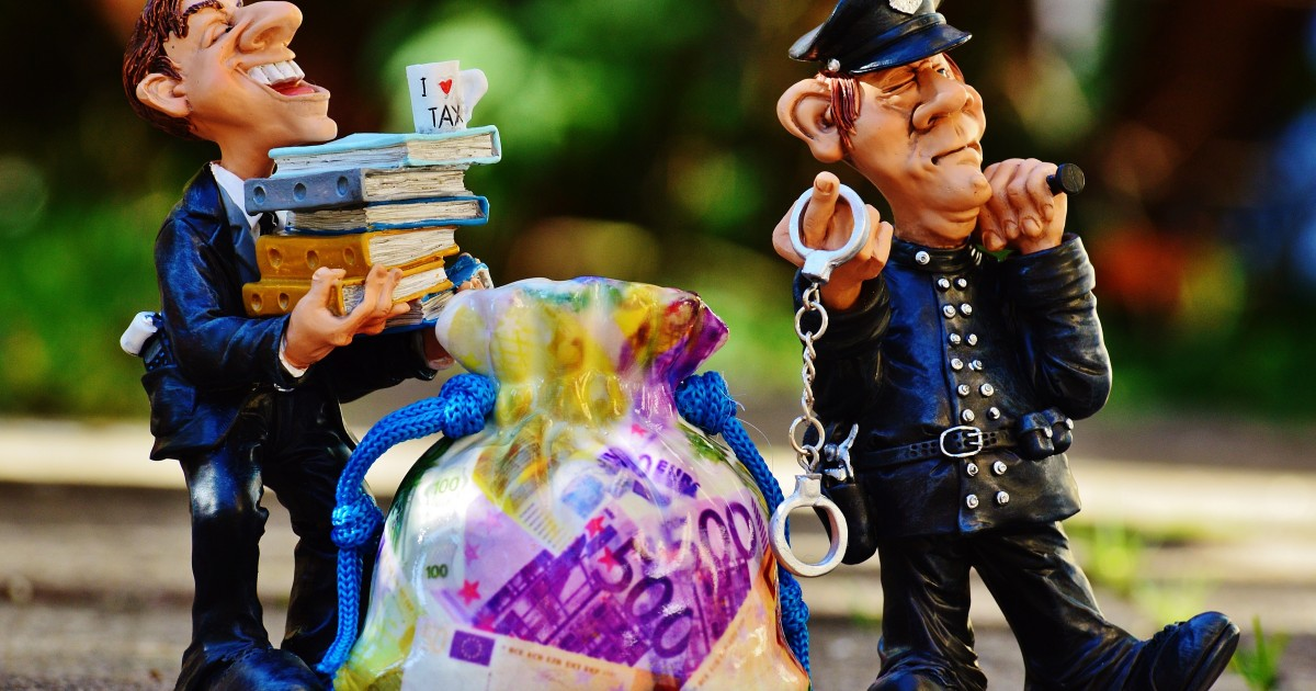 Colorful clay figures of a police man and business man with a bag of money